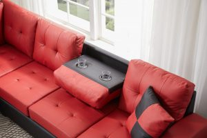Sectional 3-seaters sofa with reversible chaise, storage ottoman and cup holders ,two small pillows ,red detail1